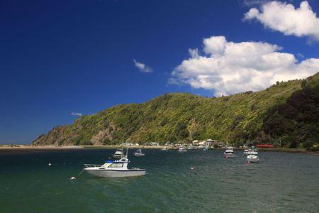 aotearoa: Small boats anchored in a bay of Whakatane, New Zealand.