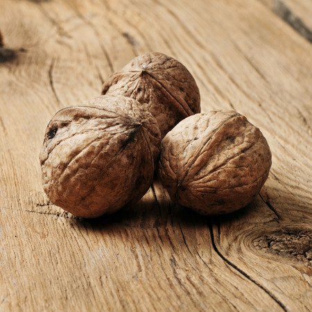 surface closeup: Walnuts on the wooden surface closeup. Stock Photo