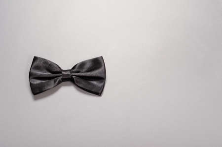 butterfly bow: Black bow tie on gray background. Stock Photo