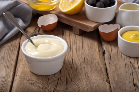 lemon: Fresh mayonnaise with ingredients for cooking homemade mayonnaise Stock Photo