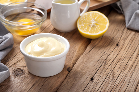 Fresh mayonnaise with ingredients for cooking homemade mayonnaise closeup Standard-Bild