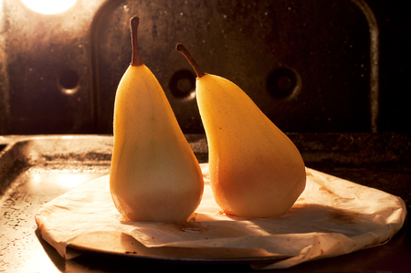Two pears in the oven ready. Backlit