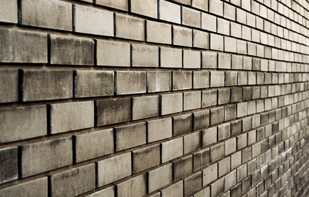 diminishing perspective: black brick wall with diminishing perspective closeup