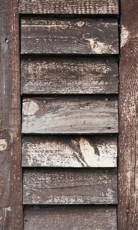 古い木製の背景。古い木製のシャッターのクローズ アップ 写真素材