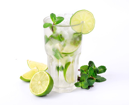 Mojito cocktail with lime and mint in tumbler glass on white background closeup Stock Photo