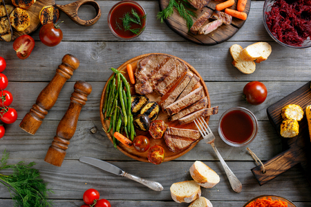 roast meat: Fillet steak grilled served with different grilled vegetables, top view Stock Photo