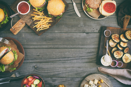Frame from various food, burgers, salad, roquefort cheese and vegetables cooked on the grill, top view. Outdoors food Concept