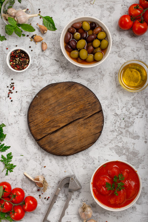 flay: Italian food cooking ingredients with wooden blank board on white background, top view