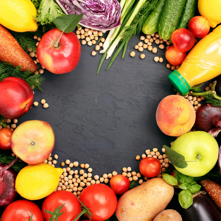 foodstuffs: Frame of colorful variety foodstuffs on a dark background, top view