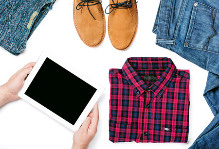 Flat lay set of various clothing for men on white background, top view