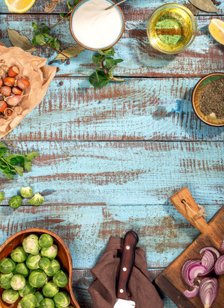 Frame of ingredients for cooking healthy food on the blue wooden table, top view. Food background. Healthy food