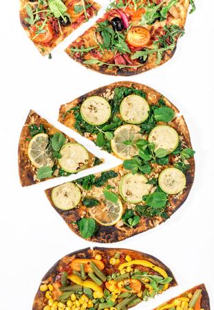tortilla de maiz: Different vegan pizza on white background, top view. Flat lay. Healthy food.