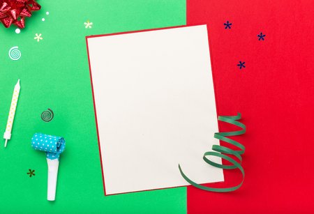 celebratory event: Blank card with different colorful celebration items on a colorful background, top view