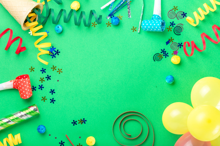 celebratory event: Frame from various celebratory items on green background, top view