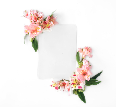 Empty card with flowers alstroemeria on white background. Flat lay, top view Stock Photo