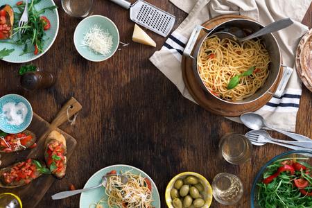 Frame Of Italian Pasta, Snacks End Wine On A Wooden Table. Italian Dinner  Table
