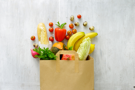 Paper bag of different fresh health food, top view  Foto de archivo