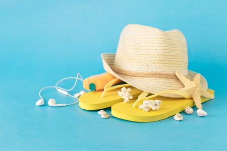 Summer background. Set beach accessories on blue background