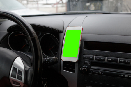 Smartphone isolated screen in holder. Smartphone use for Navigate or GPS concept