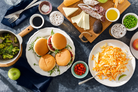 Summer party food concept top view. Various food on table flat lay. Vegetarian burgers with different foods. Vegetarian food is not only Stock Photo
