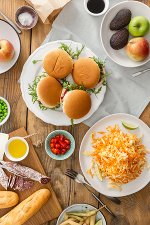 Vegetarian burgers with different foods. Vegetarian food is not only. Summer party food concept top view. Various food on table flat lay