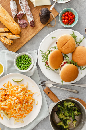 High angle view of summer party food concept. Vegetarian burgers with different foods. Vegetarian food is not only. Various food on table flat lay Reklamní fotografie