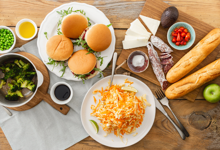 High angle view of summer party food concept. Vegetarian burgers with different foods. Stock Photo