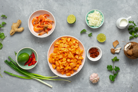 Raw ingredients for making sweet potato soup with shrimps top view Stock Photo
