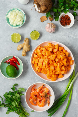 Raw ingredients for cooking sweet potato soup with shrimps top view
