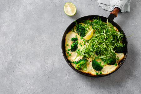 Broccoli frittata in frying pan on concrete  with copy space top view