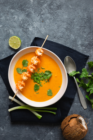 Bowl of sweet potato soup with shrimps top view