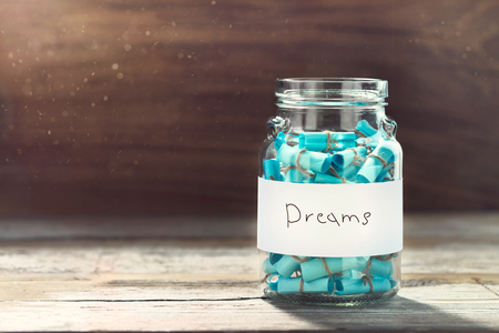 Dreams jar concept. Full glass jar of cherished wishes