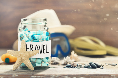 Creative travel concept Vacation planning Glass jar with list of countries to visit.