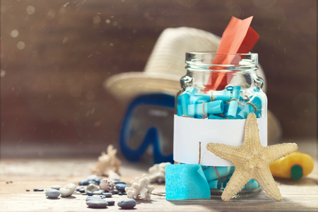 Creative travel concept, Glass jar with list of cities to visit. Vacation planning