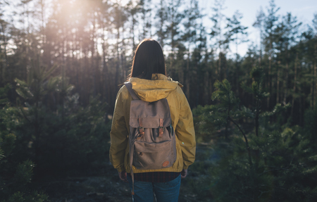 Back view woman with backpack on nature. Travel lifestyle
