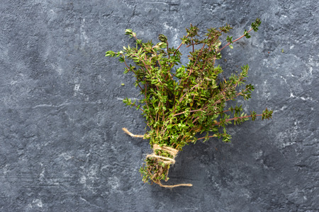 Bunch of fresh thyme on dark  top view