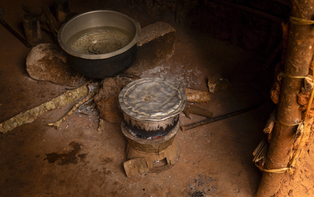 Poverty in Africa. Cooking food in poor African village