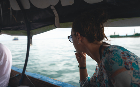 Young female traveler sailing in a local Asian boat Stock Photo