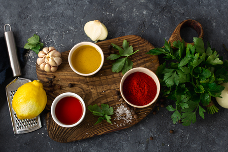 Ingredients for cooking Argentinian green Chimichurri or Chimmichurri salsa or sauce made of parsley, chili pepper, olive oil, garlic and vinegar
