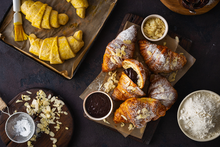 Freshly baked croissant with almond flakes and icing sugar top view Reklamní fotografie
