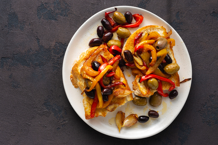 Sandwiches with grilled peppers, olives and garlic on a dark Banco de Imagens