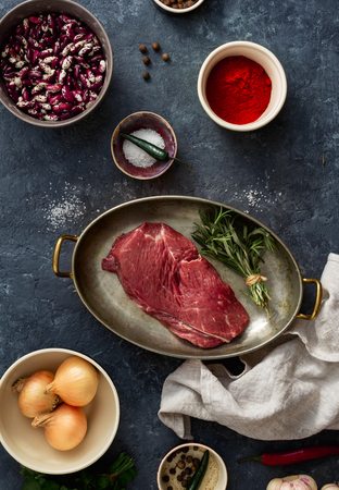 Raw steak with ingredients for cooking healthy food top view Reklamní fotografie