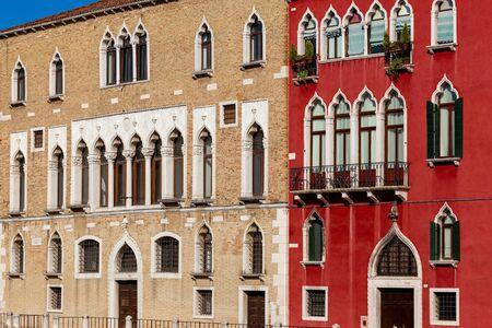 Beautiful colorful building facade in Venice, Italy. Summer cityscape