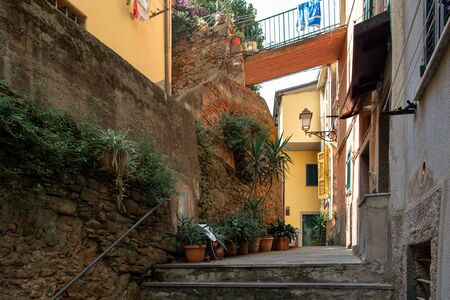 Riomaggiore in Cinque Terre, Italy. Beautiful streets with flowers. Summer cityscape Stock Photo