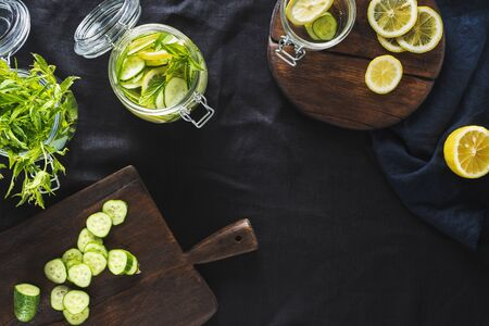 Cooking detox drink cucumber water top view. Diet concept Stock Photo