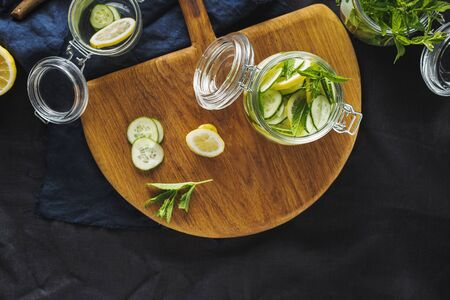 Cooking detox water cucumber drink top view. Dieting concept Stock Photo