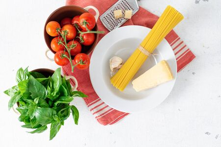 Top view raw Italian pasta with ingredients for cooking on a white background top view Stockfoto