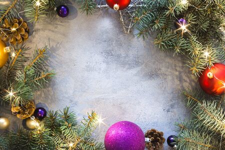 Frame of Christmas decoration on light background top view