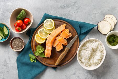 Healthy vegan food concept Ingredients for cooking poke bowl with salmon, avocado, vegetables and chia seeds top view Фото со стока
