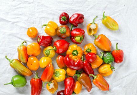 Assortment of fresh homemade pepper on white background